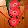 Pew end - red gerberas